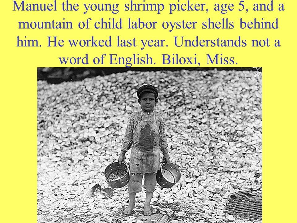 Manuel the young shrimp picker, age 5, and a mountain of child labor oyster shells behind him. He worked last year. Understands not a word of English.