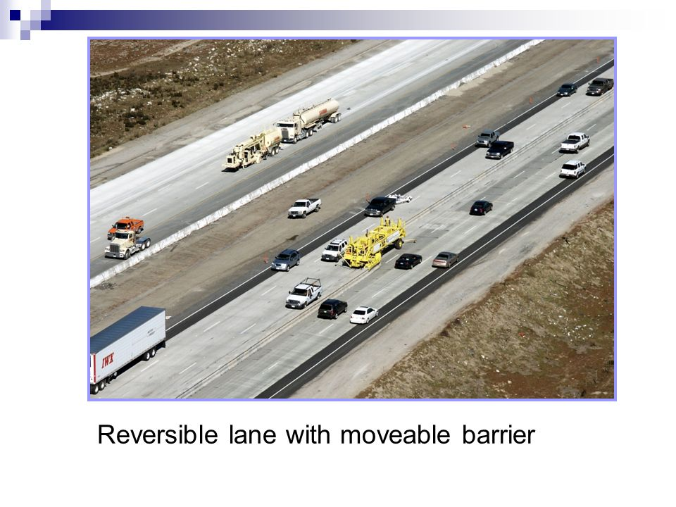 Reversible lane with moveable barrier
