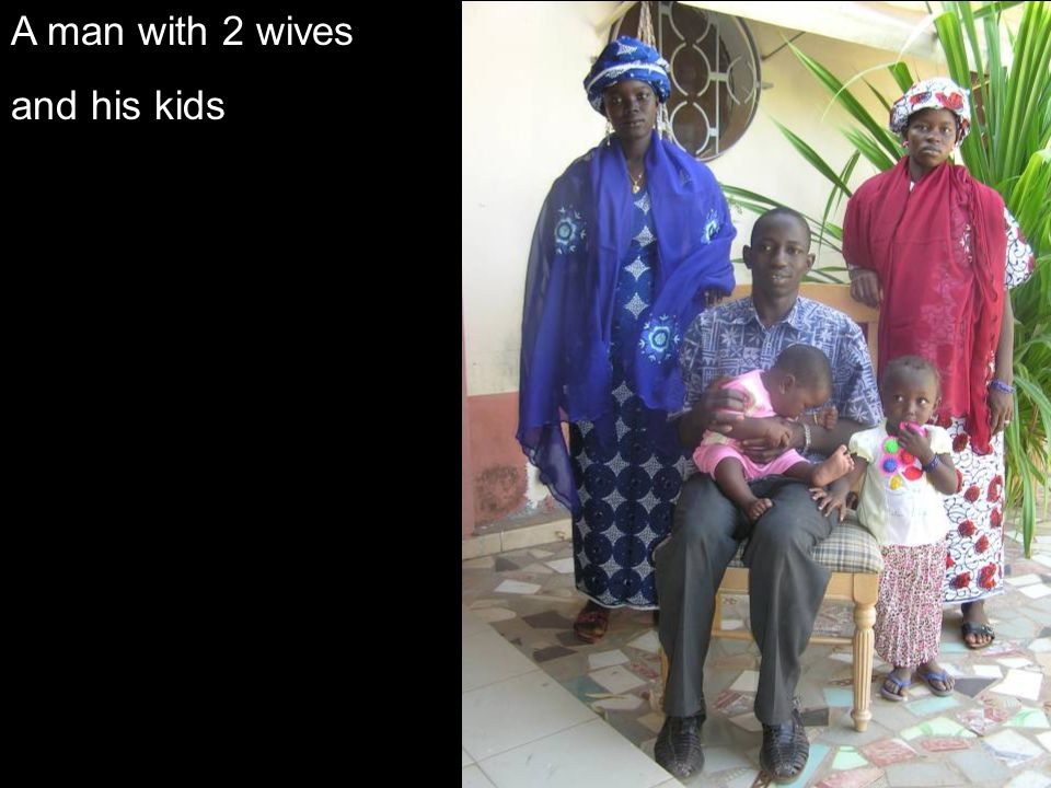 A man with 2 wives and his kids