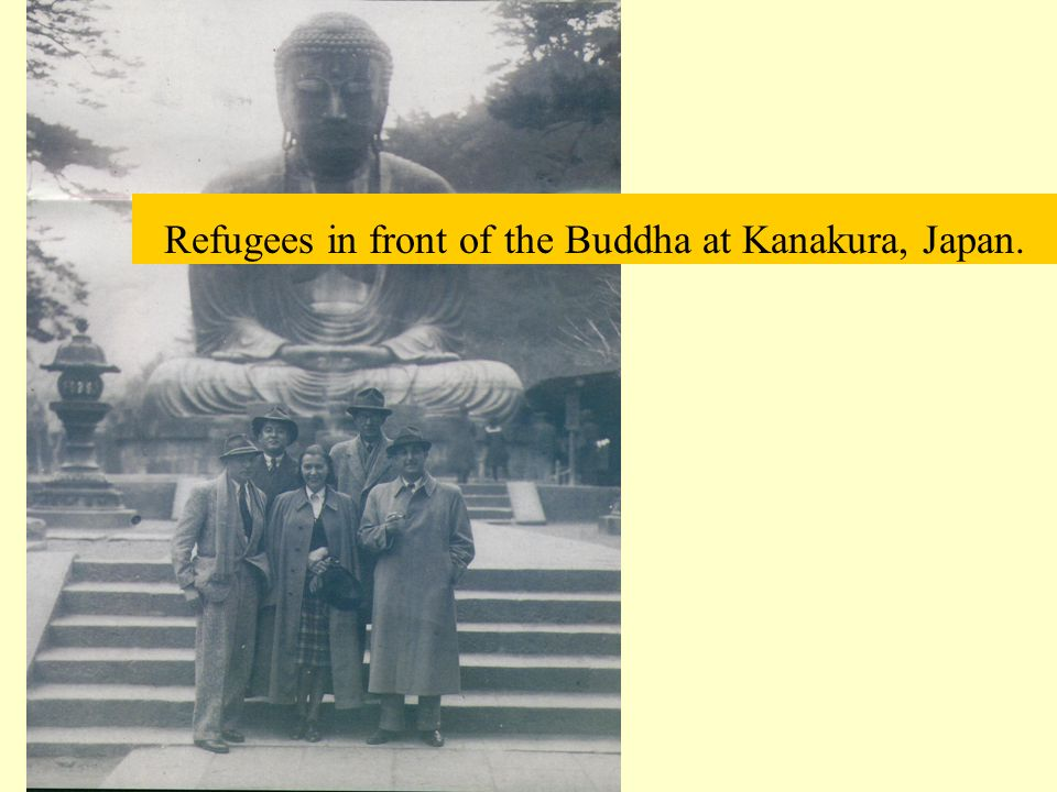 Refugees in front of the Buddha at Kanakura, Japan.