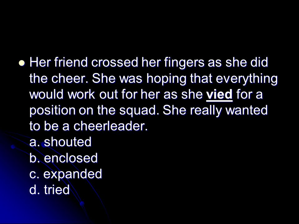 Her friend crossed her fingers as she did the cheer.
