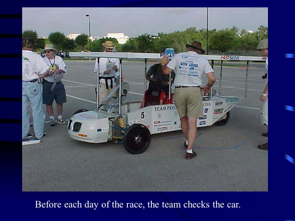Before each day of the race, the team checks the car.