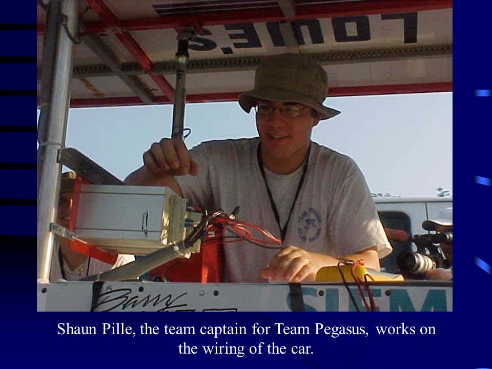 Shaun Pille, the team captain for Team Pegasus, works on the wiring of the car.