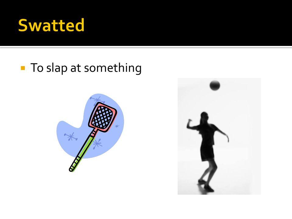 To slap at something