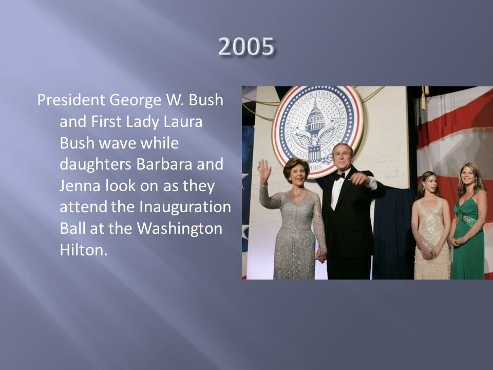 President George W. Bush and First Lady Laura Bush wave while daughters Barbara and Jenna look on as they attend the Inauguration Ball at the Washingt