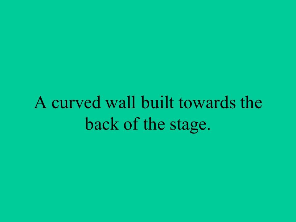 A curved wall built towards the back of the stage.