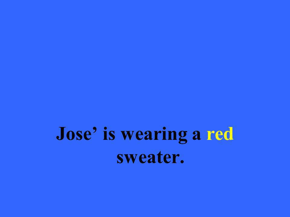 Jose is wearing a red sweater.