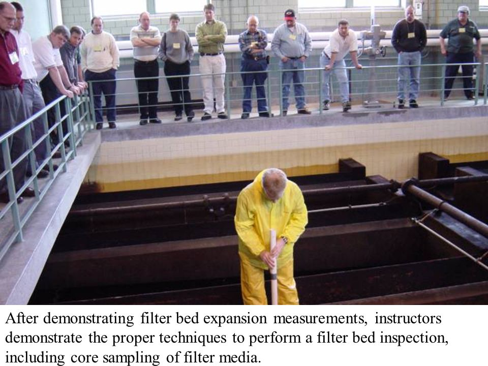 After demonstrating filter bed expansion measurements, instructors demonstrate the proper techniques to perform a filter bed inspection, including cor