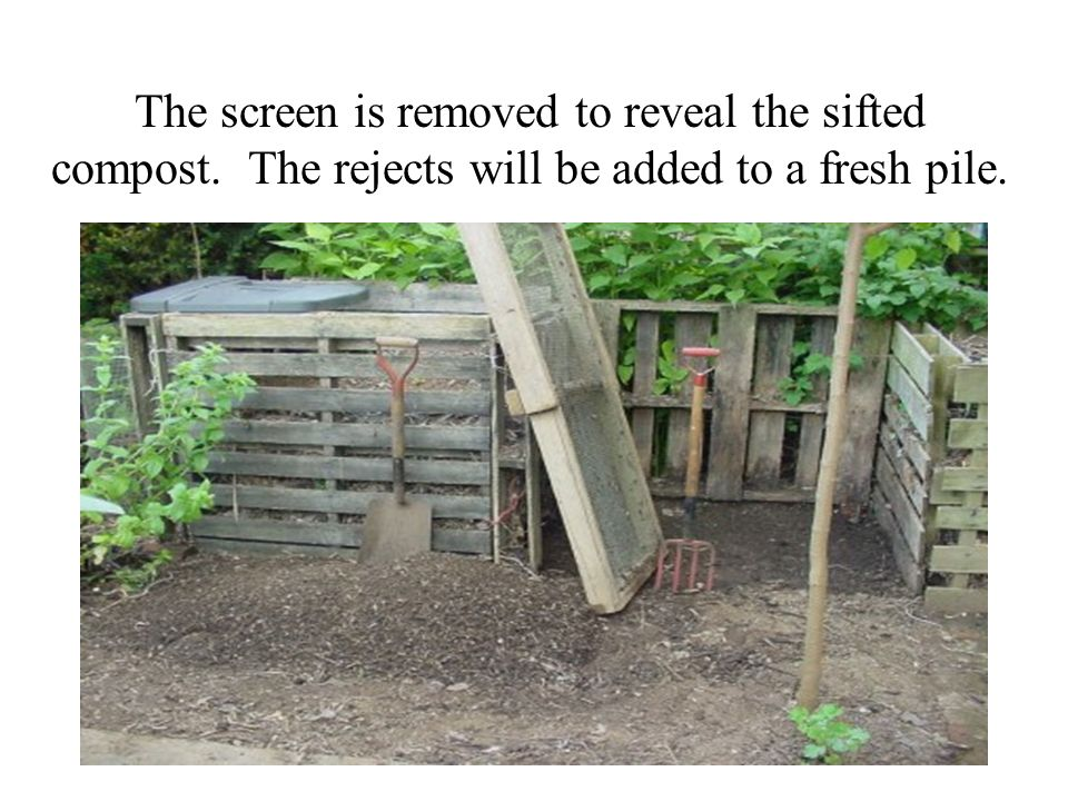 The screen is removed to reveal the sifted compost. The rejects will be added to a fresh pile.