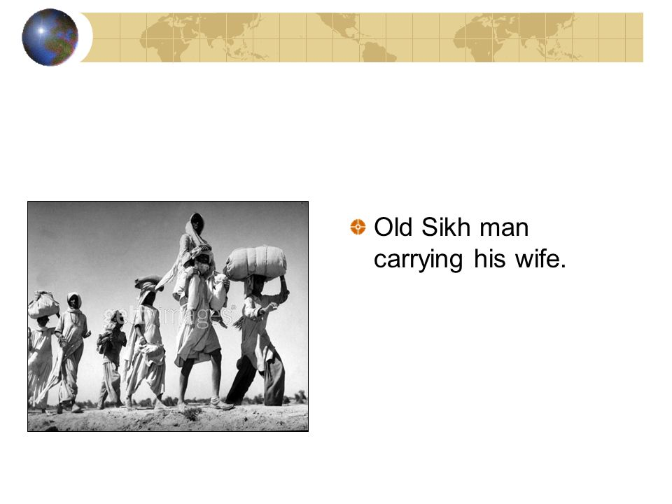 Old Sikh man carrying his wife.