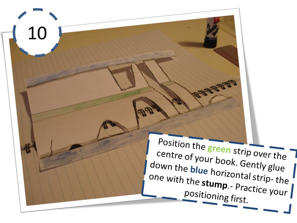 10 Position the green strip over the centre of your book. Gently glue down the blue horizontal strip- the one with the stump.- Practice your positioni