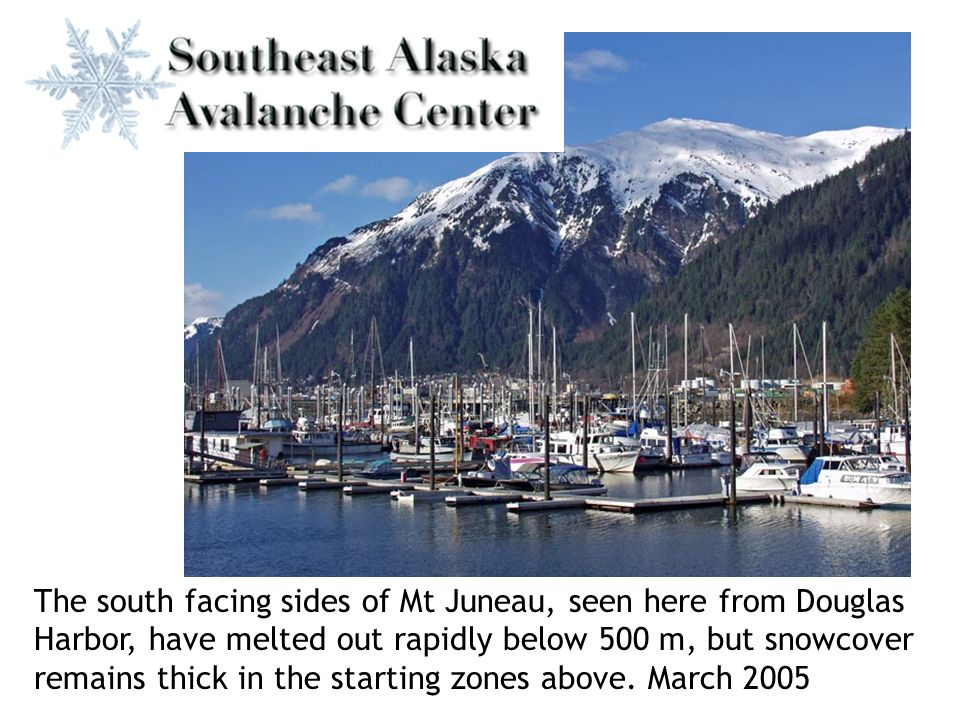 The south facing sides of Mt Juneau, seen here from Douglas Harbor, have melted out rapidly below 500 m, but snowcover remains thick in the starting zones above.
