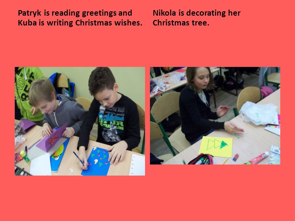 Patryk is reading greetings and Kuba is writing Christmas wishes.