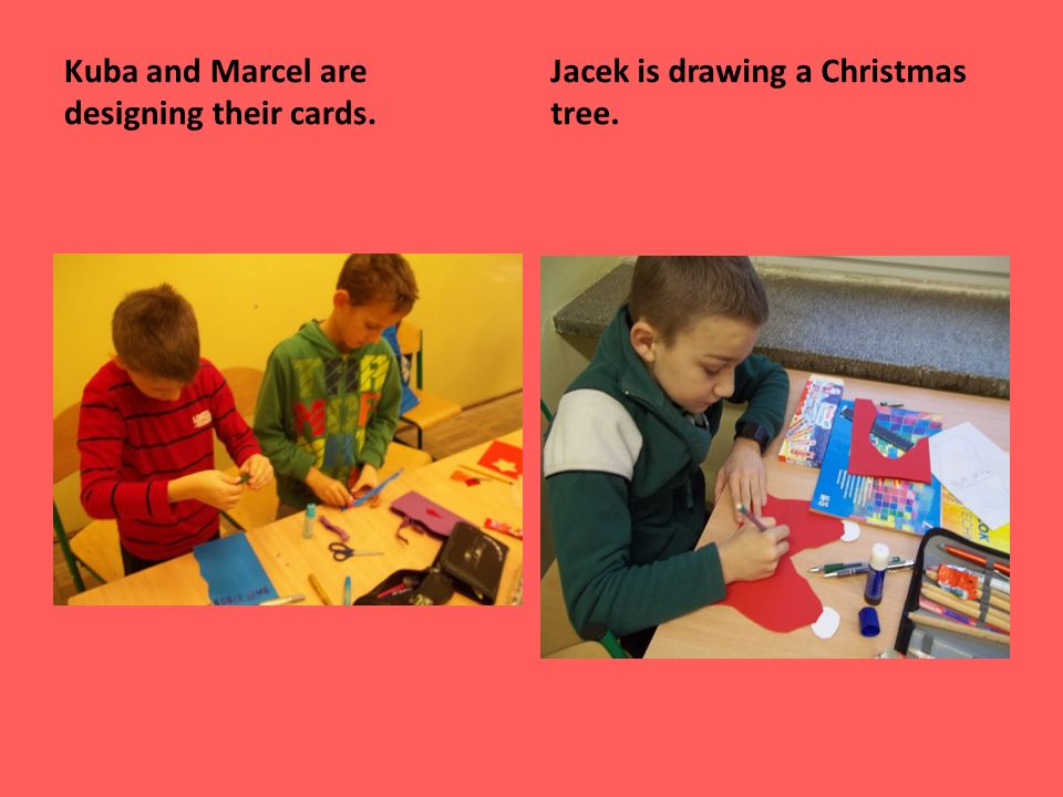 Kuba and Marcel are designing their cards. Jacek is drawing a Christmas tree.