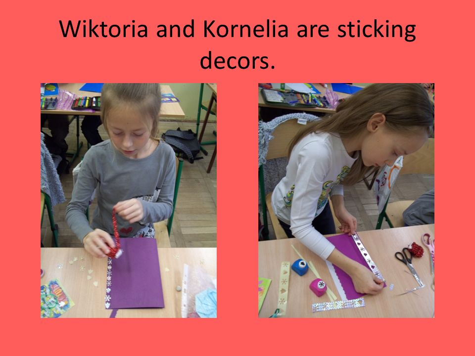 Wiktoria and Kornelia are sticking decors.