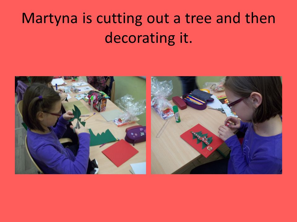 Martyna is cutting out a tree and then decorating it.