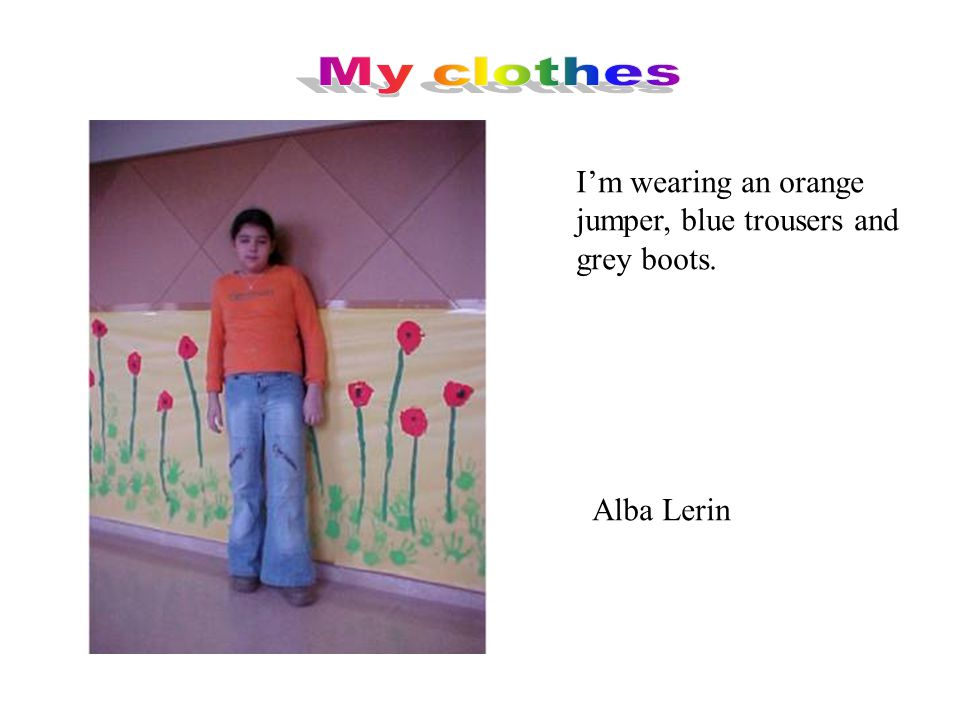 I'm wearing an orange and white jumper. I'm wearing blue trousers and brown shoes. Aitor