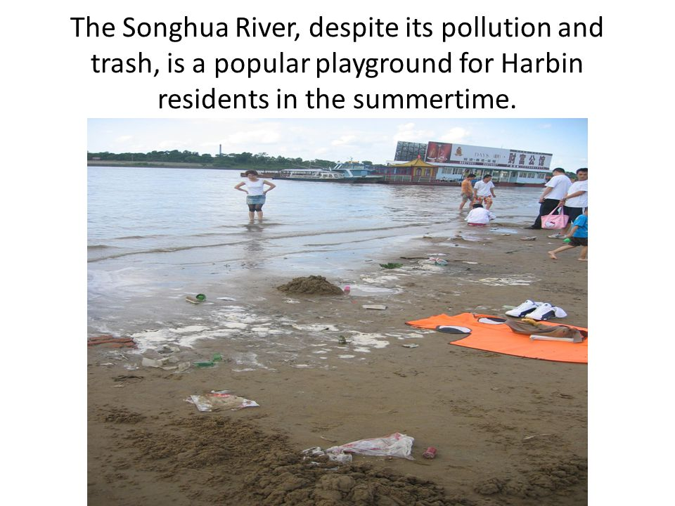 The Songhua River, despite its pollution and trash, is a popular playground for Harbin residents in the summertime.