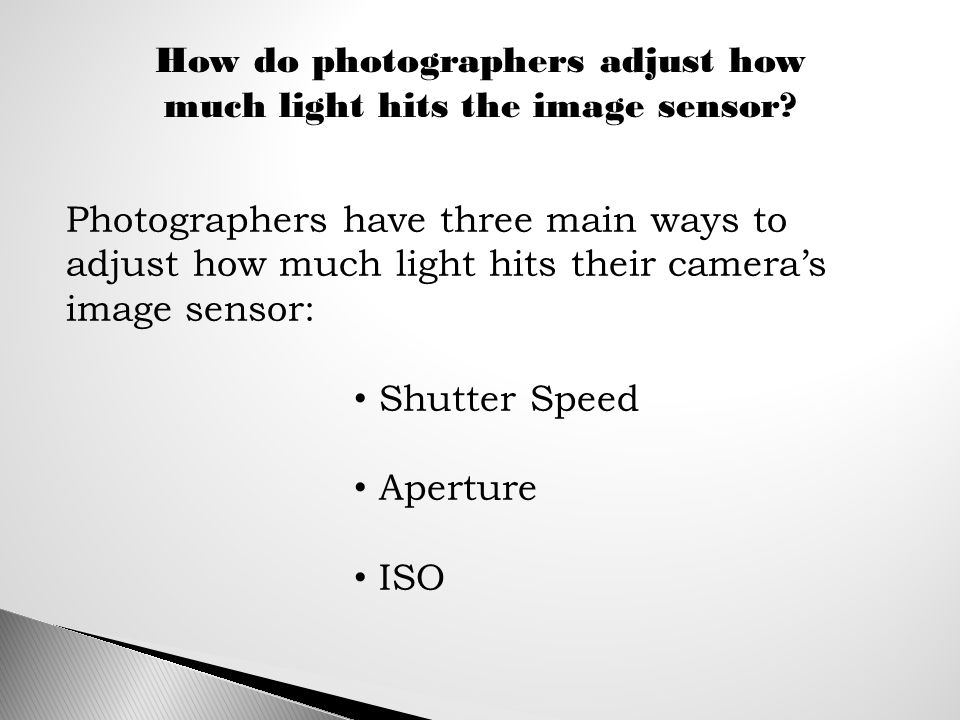 How do photographers adjust how much light hits the image sensor.