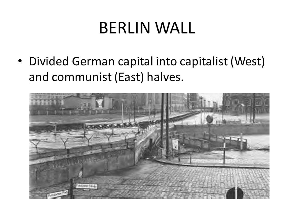 BERLIN WALL Divided German capital into capitalist (West) and communist (East) halves.