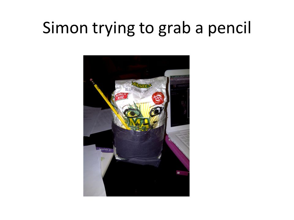Simon trying to grab a pencil