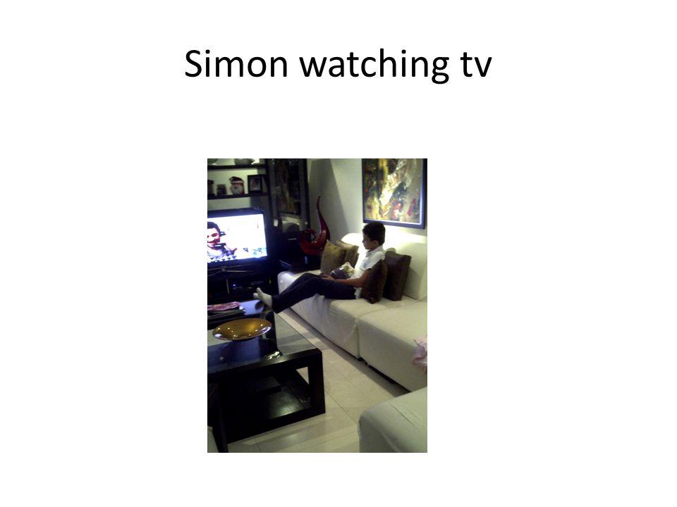 Simon watching tv