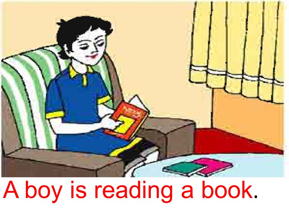 A boy is reading a book.