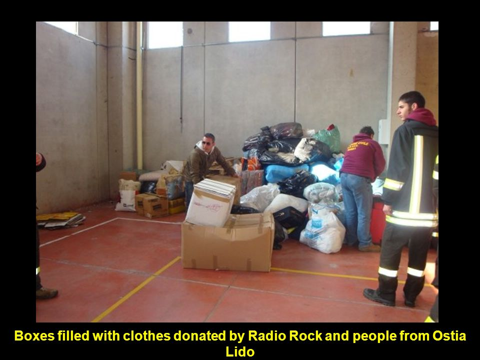 Boxes filled with clothes donated by Radio Rock and people from Ostia Lido