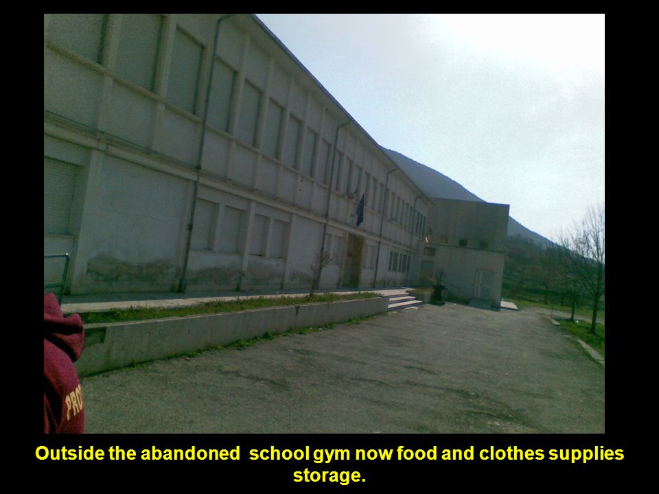 Outside the abandoned school gym now food and clothes supplies storage.