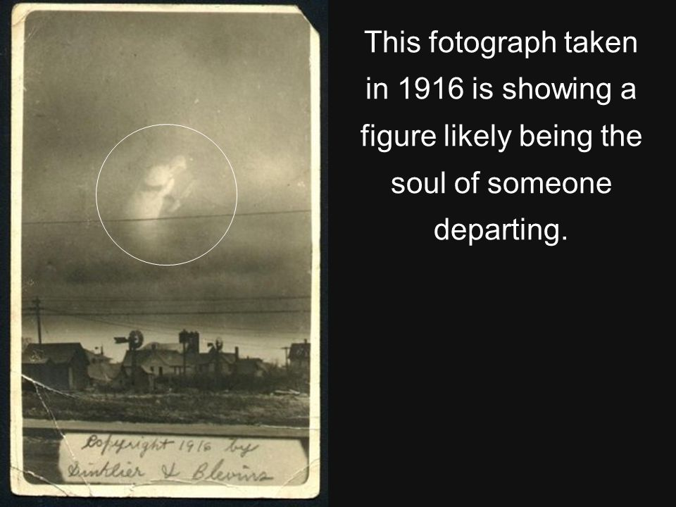 This fotograph taken in 1916 is showing a figure likely being the soul of someone departing.