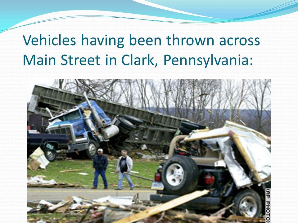 Vehicles having been thrown across Main Street in Clark, Pennsylvania:
