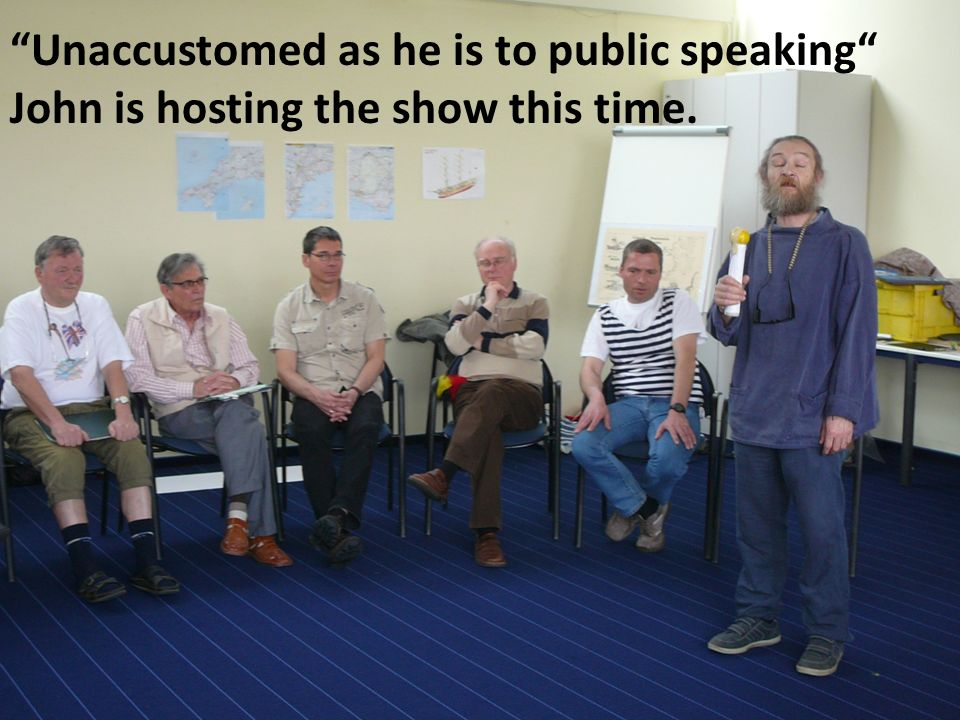 Unaccustomed as he is to public speaking John is hosting the show this time.