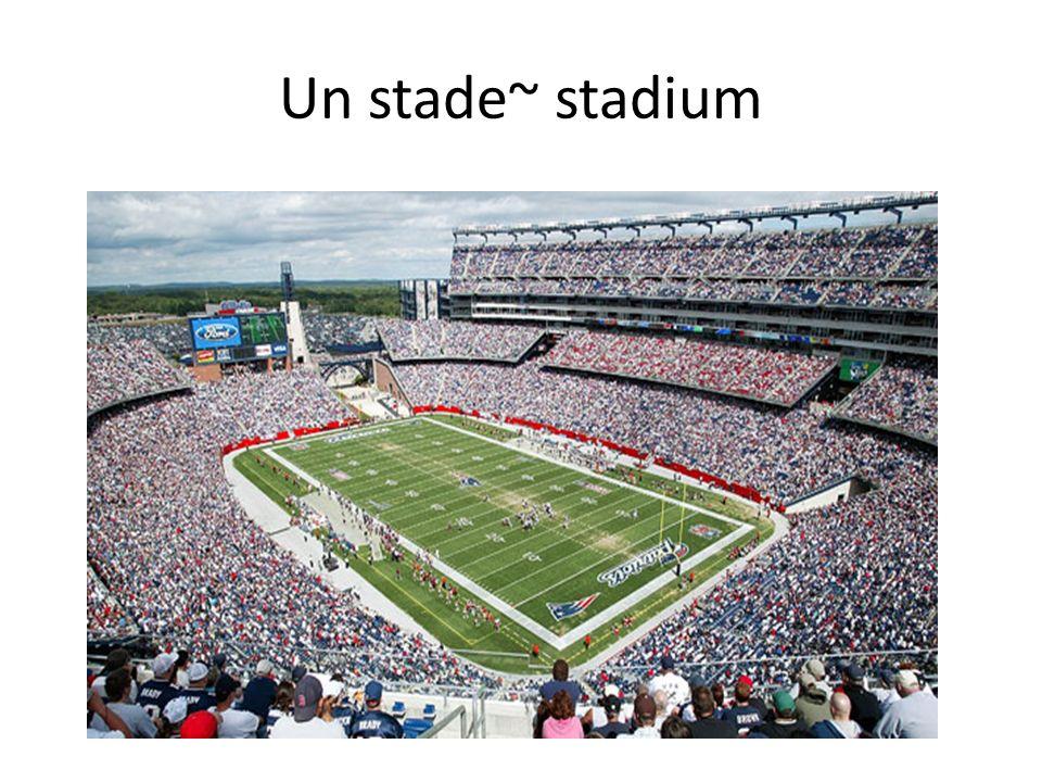 Un stade~ stadium