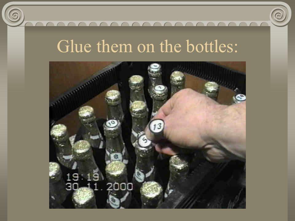 Glue them on the bottles: