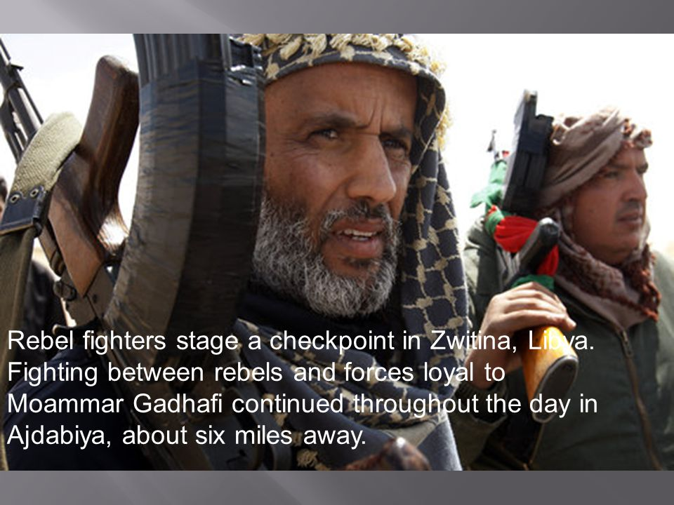 Rebel fighters stage a checkpoint in Zwitina, Libya.