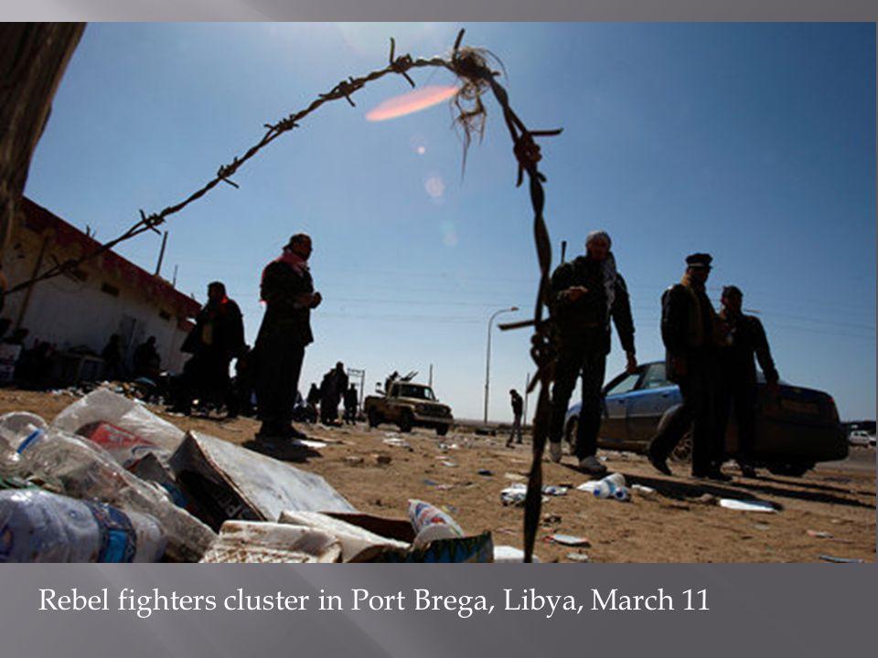 Rebel fighters cluster in Port Brega, Libya, March 11