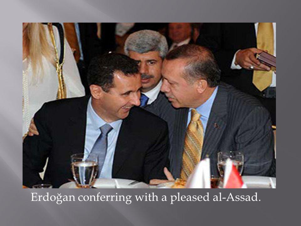 Erdoğan conferring with a pleased al-Assad.