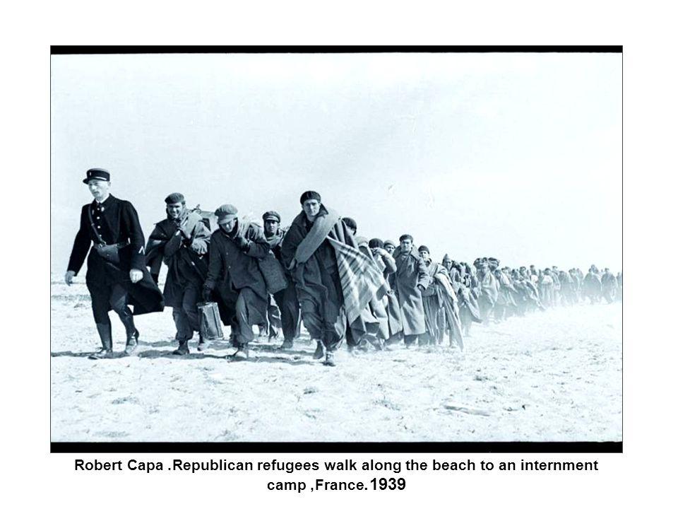 Robert Capa. Republican refugees walk along the beach to an internment camp, France 1939.