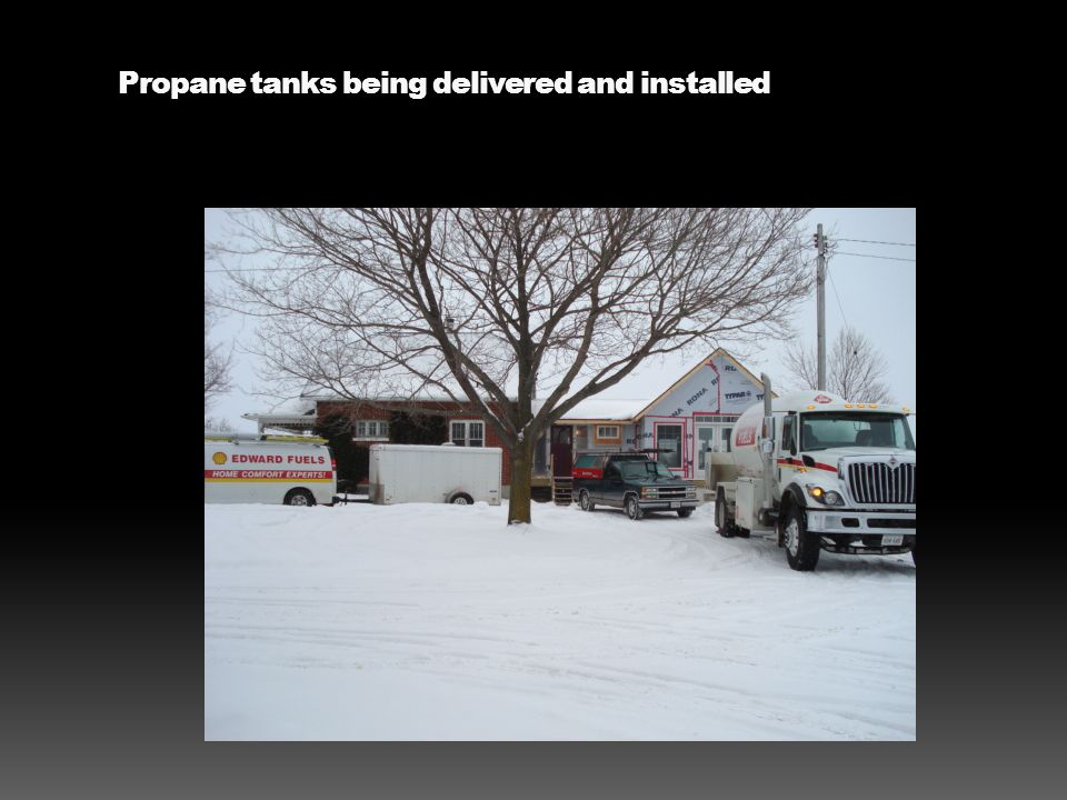 Propane tanks being delivered and installed