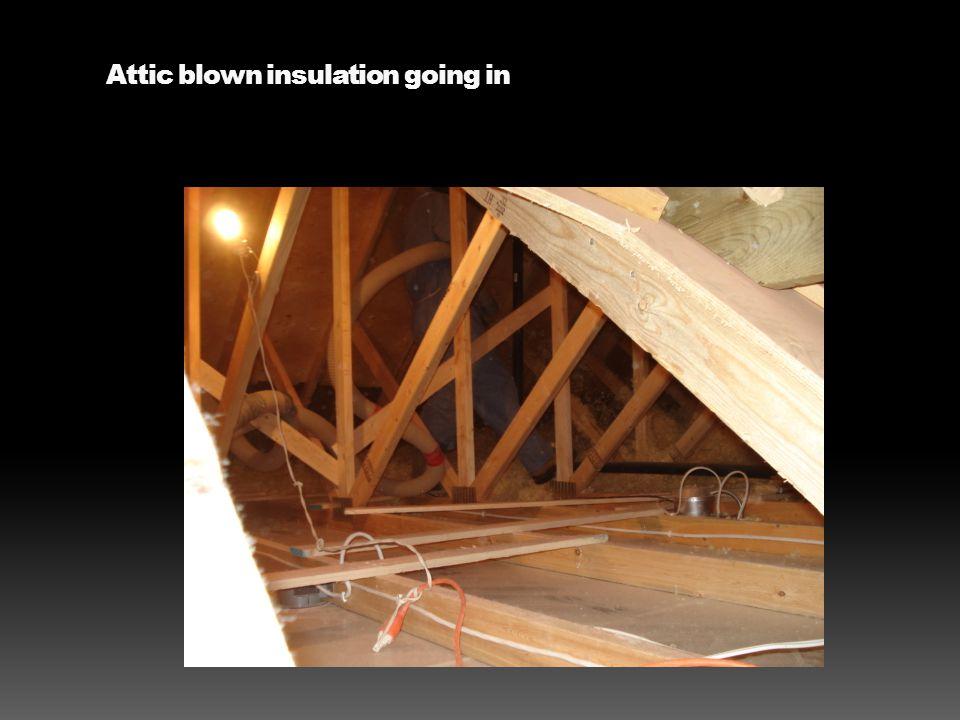 Attic blown insulation going in