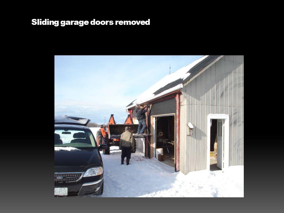 Sliding garage doors removed
