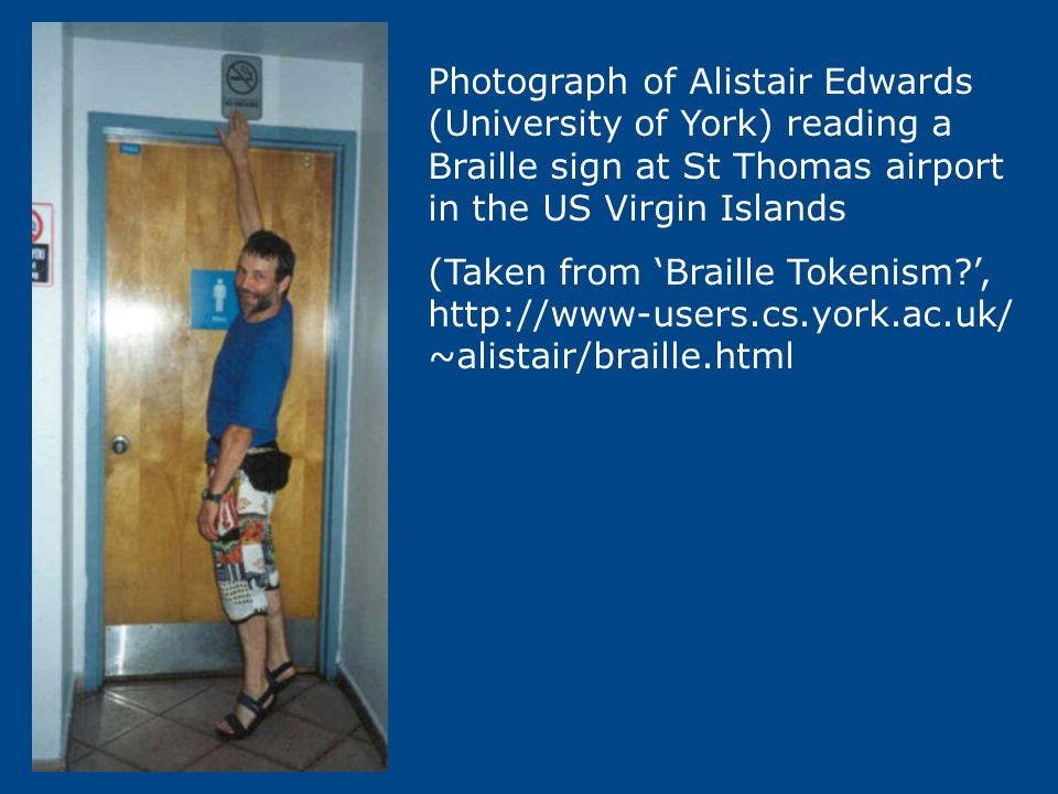 Photograph of Alistair Edwards (University of York) reading a Braille sign at St Thomas airport in the US Virgin Islands (Taken from Braille Tokenism?