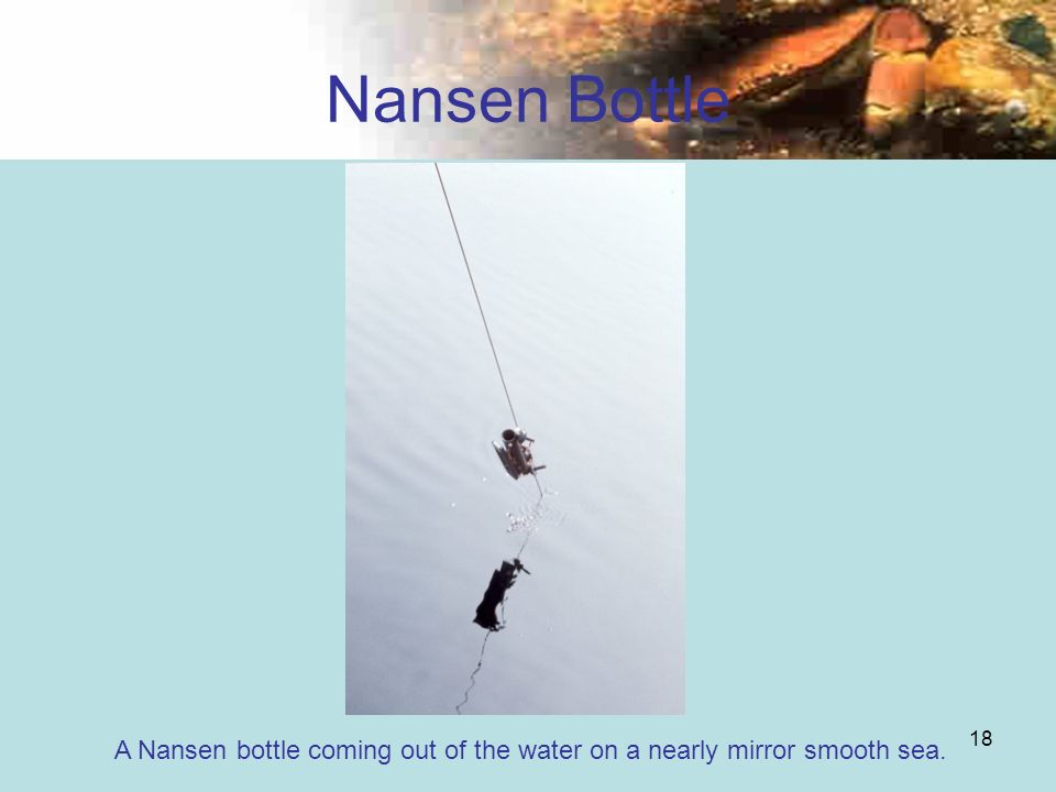 18 Nansen Bottle A Nansen bottle coming out of the water on a nearly mirror smooth sea.