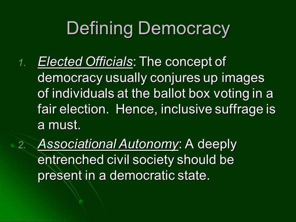 Defining Democracy 1. Elected Officials: The concept of democracy usually conjures up images of individuals at the ballot box voting in a fair electio