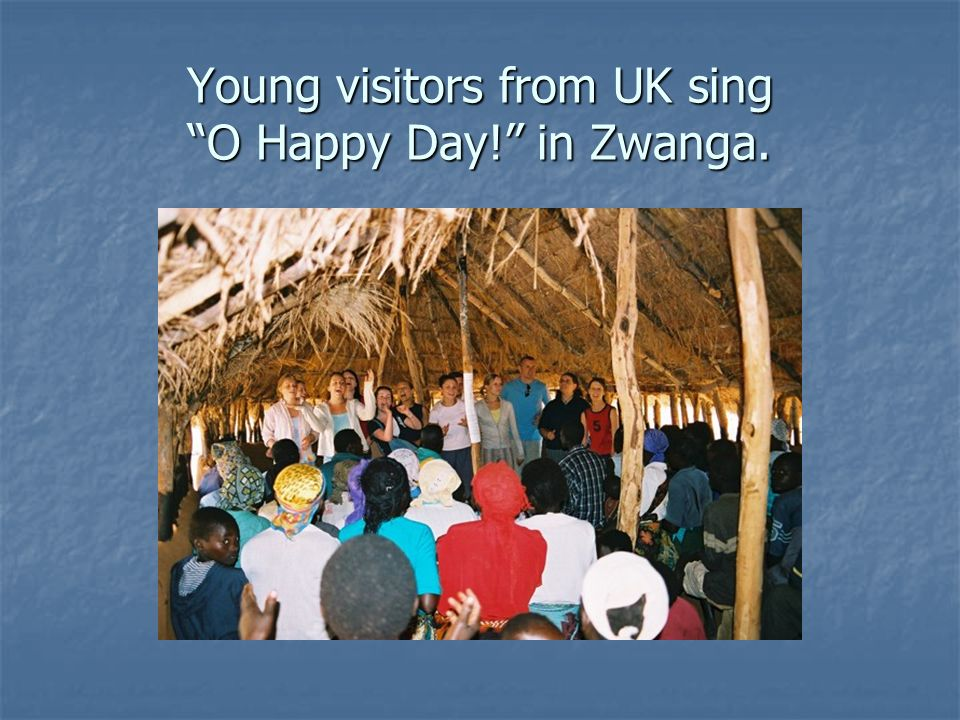 Young visitors from UK sing O Happy Day! in Zwanga.