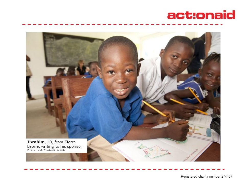 Ibrahim, 10, from Sierra Leone, writing to his sponsor PHOTO: DES WILLIE/ACTIONAID