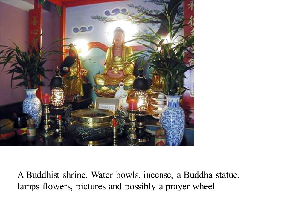 A Buddhist shrine, Water bowls, incense, a Buddha statue, lamps flowers, pictures and possibly a prayer wheel