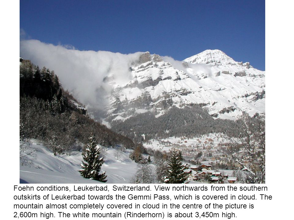 Foehn conditions, Leukerbad, Switzerland. View northwards from the southern outskirts of Leukerbad towards the Gemmi Pass, which is covered in cloud.