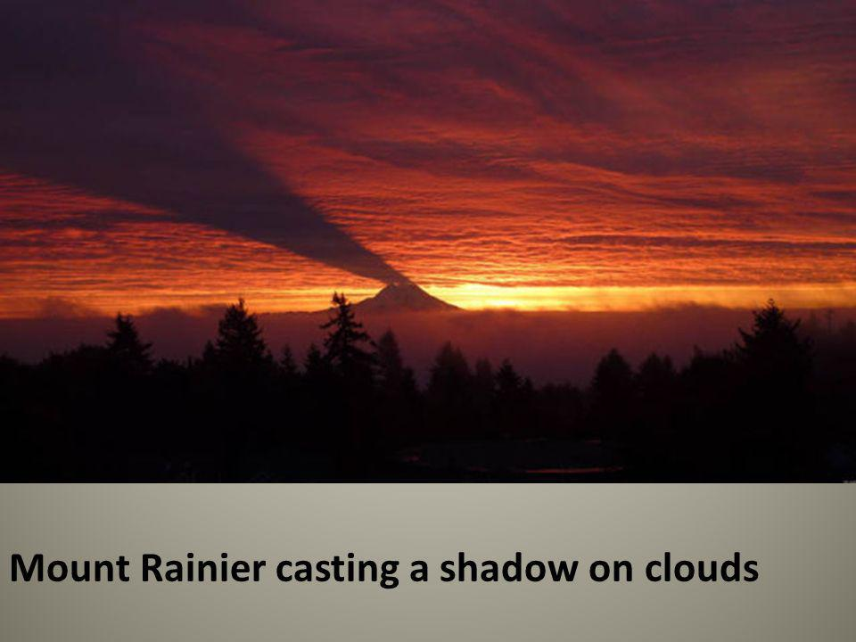 Mount Rainier casting a shadow on clouds
