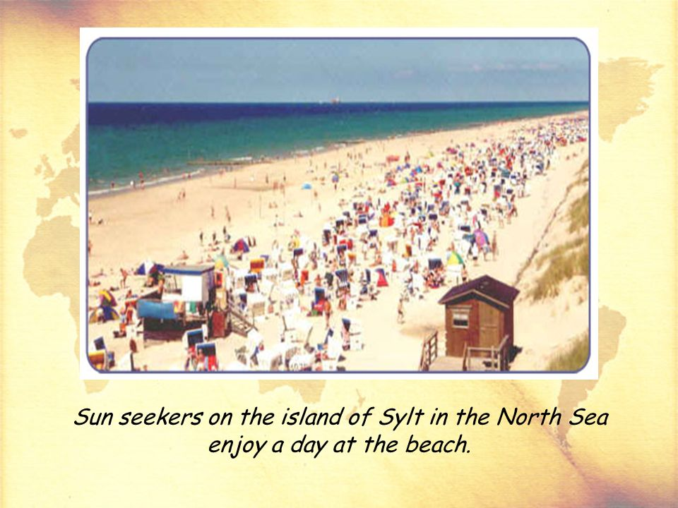 Sun seekers on the island of Sylt in the North Sea enjoy a day at the beach.